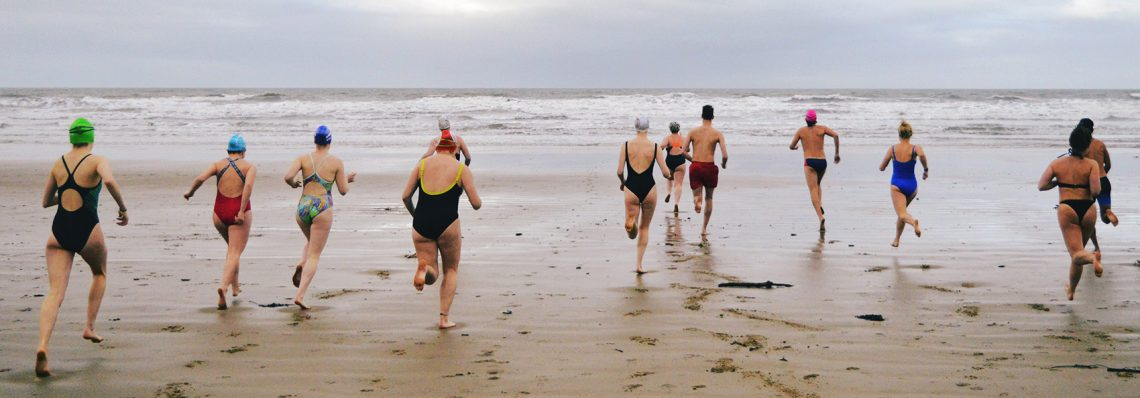 swimmers running into sea by henry parker