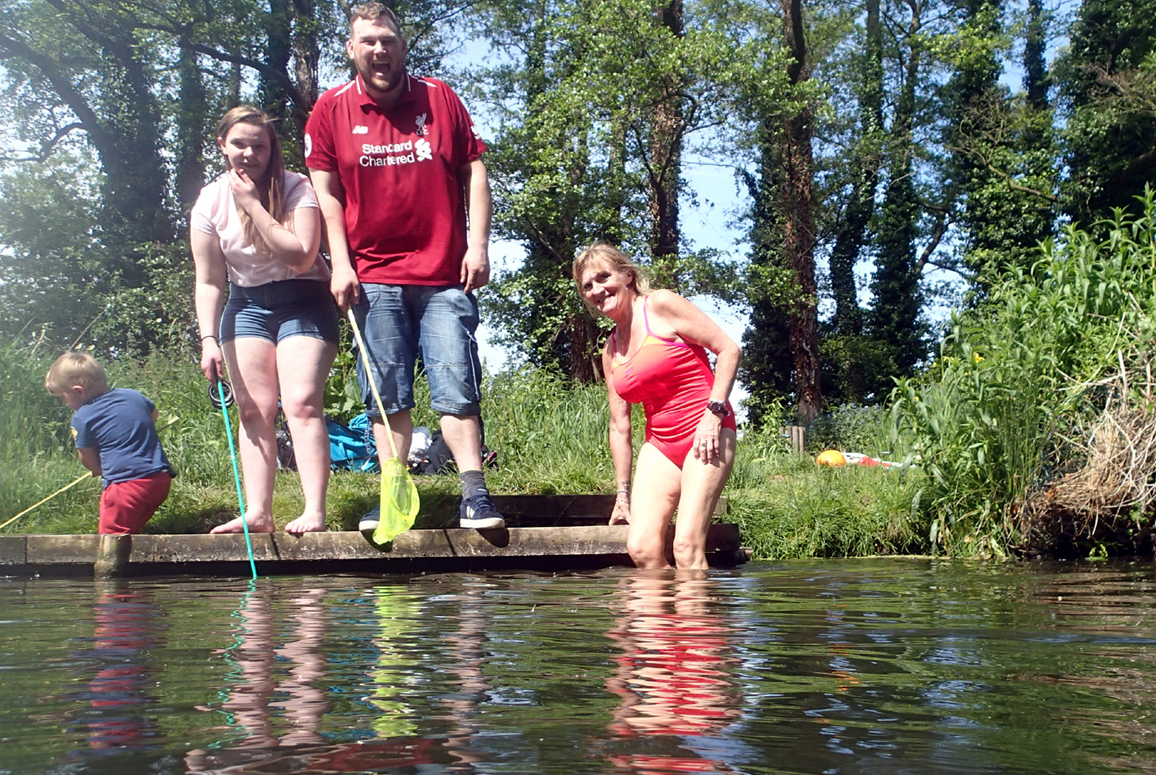 family and river swimmer