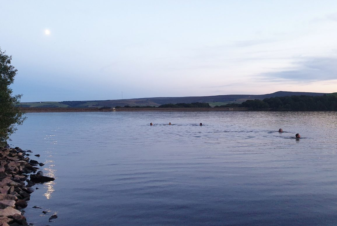 still water and swimmers in reservoir