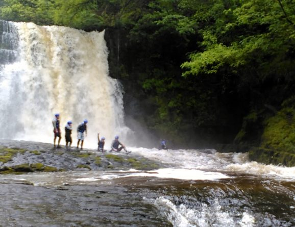 waterfall with helmeted water users