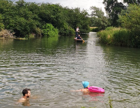 swimmers and punt in river Cam
