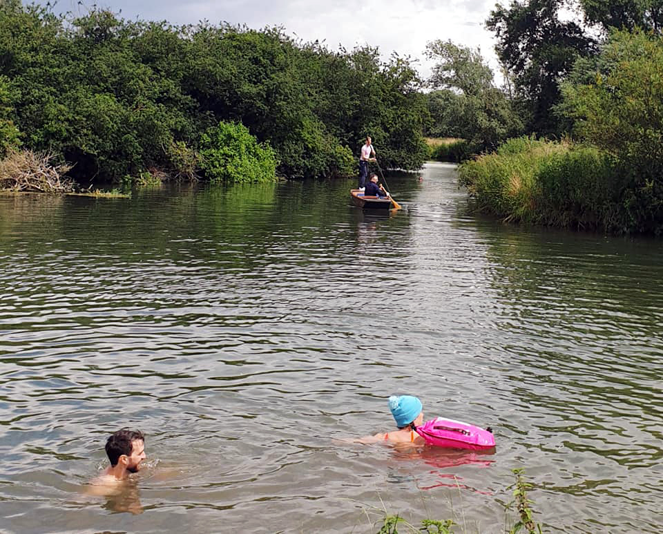 swimmers and boaters in river