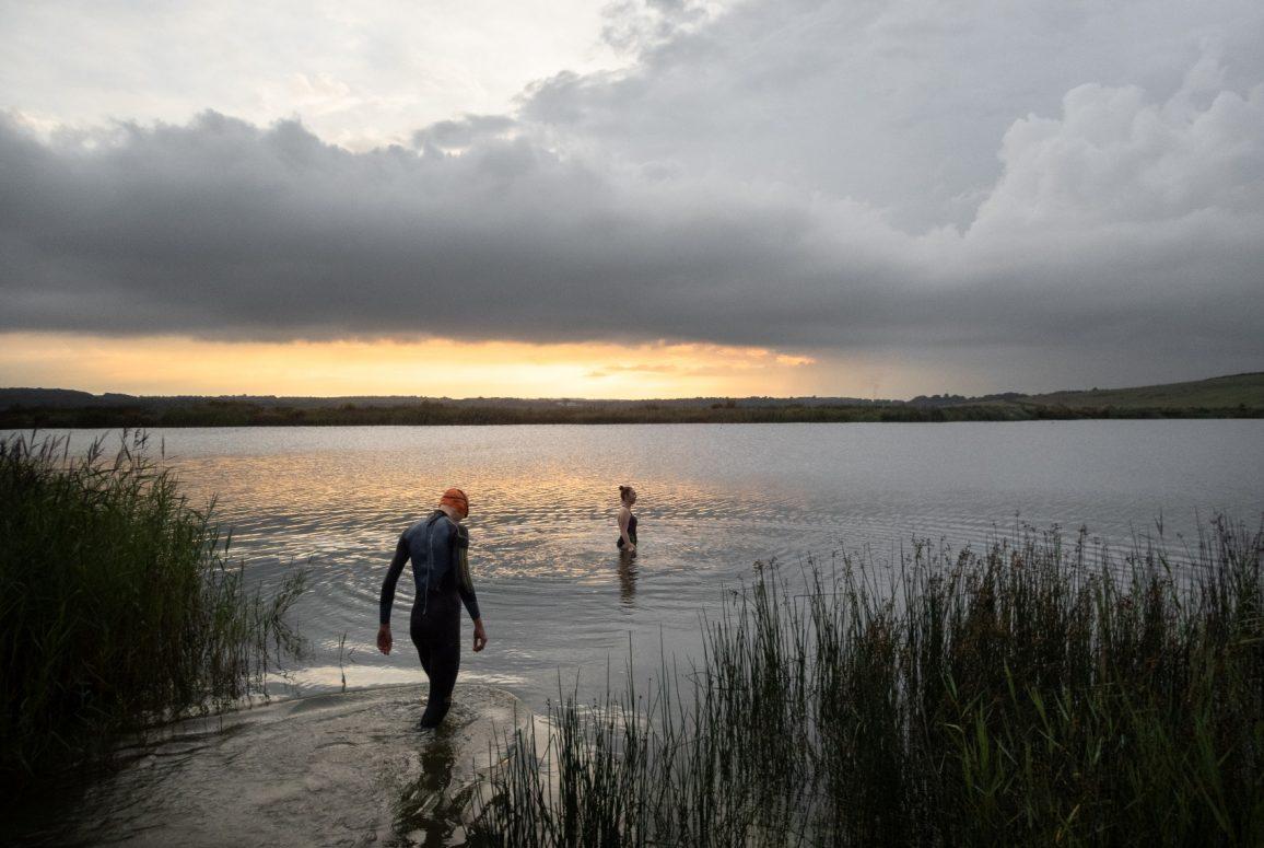 swimmers sunset lake